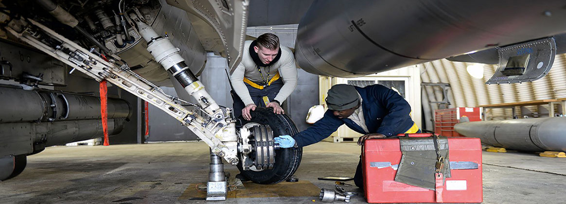 KUNSAN AIR BASE, Republic of Korea (Jan. 10, 2018) - U.S. Air Force Staff Sgt. William Horne and Senior Airman Isiah Bishop, 80th Fighter Squadron crew chiefs, change a left main-tire at Kunsan Air Base. The crew chiefs and maintainers who work on swing shift to keep the 80th Fighter Squadron mission ready have a saying that reminds them no matter the weather condition, they have a job to do, and they'll