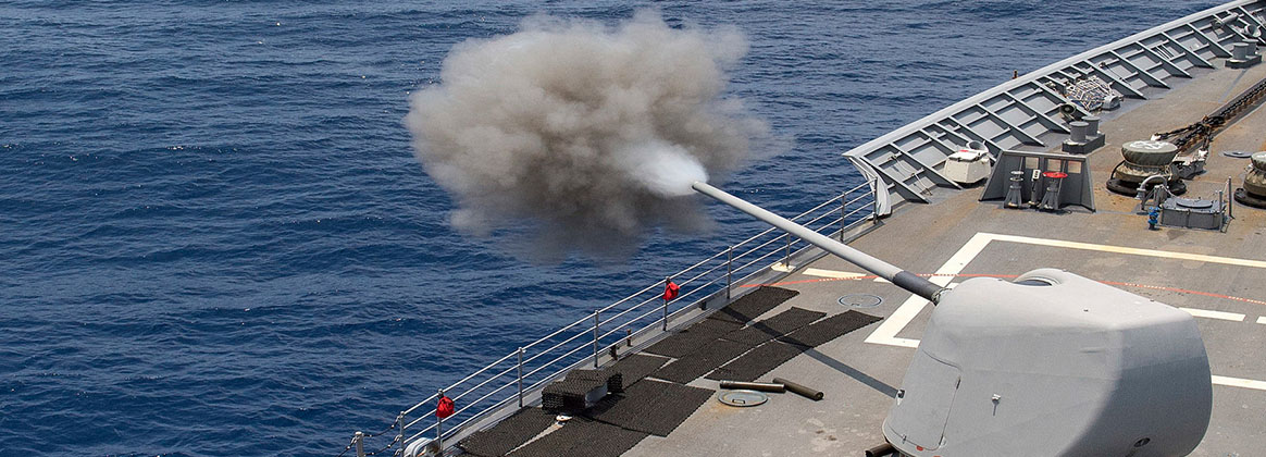 PACIFIC OCEAN (July 15, 2018) - The guided-missile cruiser USS Lake Champlain (CG 57) fires one of its Mark 45 5-inch guns during a live-fire exercise during Rim of the Pacific (RIMPAC) exercise.  Twenty-five nations, 46 ships and 5 submarines, and about 200 aircraft and 25,000 personnel are participating RIMPAC from June 27 to Aug. 2 in and around the Hawaiian Islands and Southern California. The world's largest international maritime exercise, RIMPAC provides a unique training opportunity while fostering and sustaining cooperative relationships among participants critical to ensuring the safety of sea lanes and security of the world's oceans. RIMPAC 2018 is the 26th exercise in the series that began in 1971.