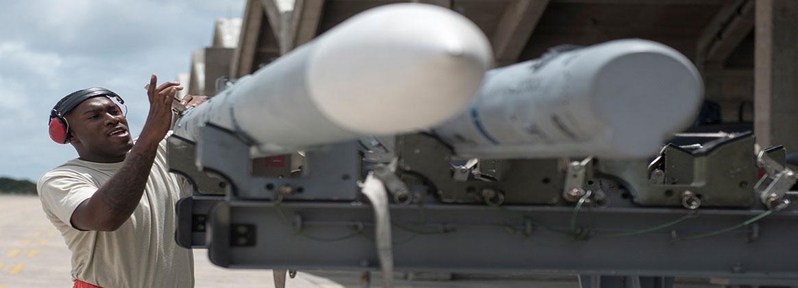 KADENA AIR BASE, Japan (July 16, 2018) - Staff Sgt. James Smith, 67th Aircraft Maintenance Unit weapons load crew chief, inspects AIM-120 advanced medium-range air-to-air missiles during an annual