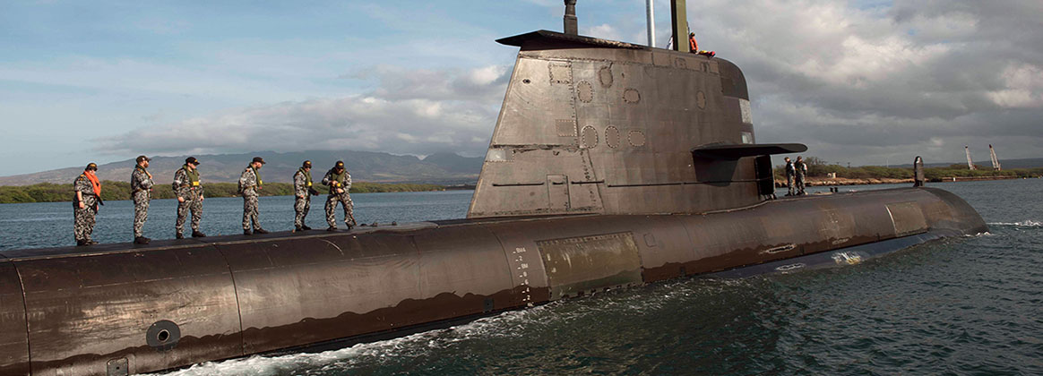 PEARL HARBOR (July 17, 2018) - The crew of the Royal Australian Navy submarine HMAS Rankin (SSG 78) enters Pearl Harbor for a brief stop for personnel during the Rim of the Pacific (RIMPAC) exercise. Twenty-five nations, 46 ships, five submarines, about 200 aircraft and 25,000 personnel are participating in RIMPAC from June 27 to Aug. 2 in and around the Hawaiian Islands and Southern California. The world's largest international maritime exercise, RIMPAC provides a unique training opportunity while fostering and sustaining cooperative relationships among participants critical to ensuring the safety of sea lanes and security of the world's oceans. RIMPAC 2018 is the 26th exercise in the series that began in 1971.