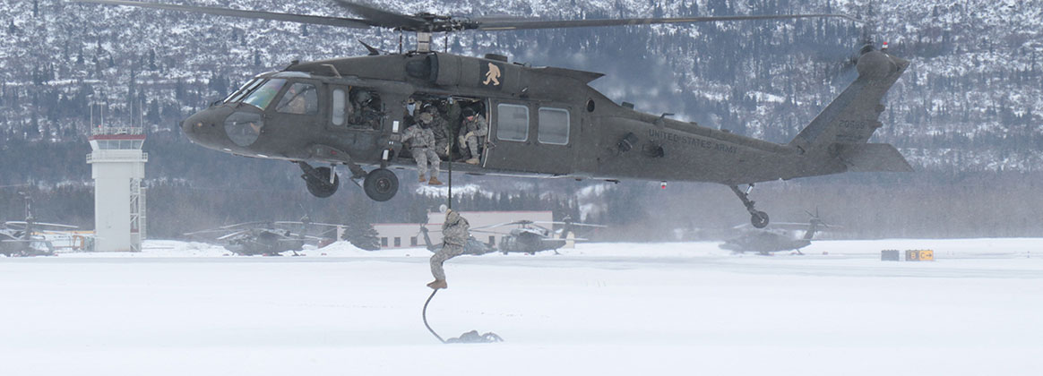 JOINT BASE ELMENDORF-RICHARDSON, Alaska (Jan. 16, 2019) - Soldiers from 1st Stryker Brigade Combat Team, U.S. Army Alaska, train USARAK and 4th Infantry Brigade Combat Team (Airborne) Soldiers on the Army Fast Rope Insertion/Extraction System at Bryant Army Airfield on Joint Base Elmendorf-Richardson (JBER). USARAK Soldiers conducted three FRIES descents from a UH60 Blackhawk helicopter in sub-freezing temperatures.