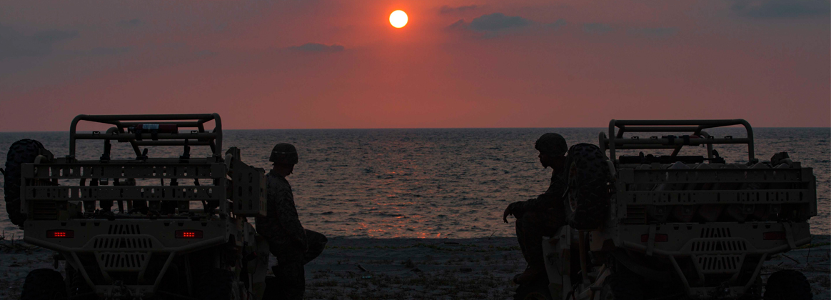 NAVY EDUCATION AND TRAINING COMMAND, PHILIPPINES (April 7, 2019) - U.S. Marine Corps Lance Cpl. Alexander Weston (left) and Lance Cpl. Jose Gonzalez (right) sit on their Utility Terrain Vehicles observing the sunset after a training event at the Navy Education and Training Command, Philippines, during Exercise Balikatan on Apr. 7, 2019.  Both Weston, a Mortarman, and Gonzalez a rifleman, are with 3rd Battalion, 6th Marines currently attached to 4th Marine Regiment, 3rd Marine Division. Exercise Balikatan, in its 35th iteration, is an annual U.S.-Philippine military training focused on a variety of missions, including humanitarian assistance and disaster relief, counter-terrorism, and other combined military operations held from April 1 to April 12.