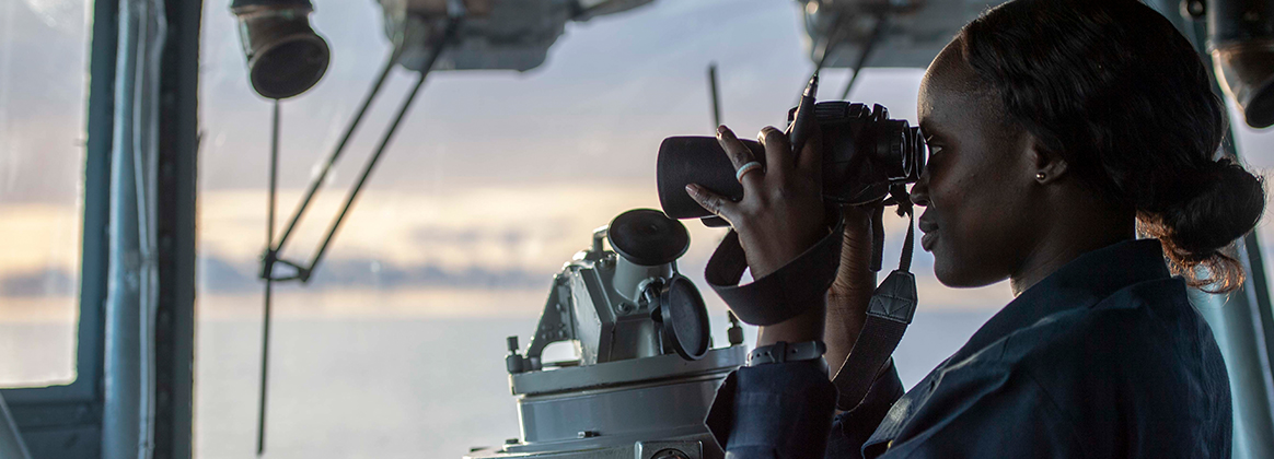 INDIAN OCEAN (June 21, 2019) Ens. Marieme Gueye, from Arlington, Texas, assigned to amphibious assault ship USS Boxer (LHD 4), stands watch on the bridge. The Boxer Amphibious Ready Group (ARG) and 11th Marine Expeditionary Unit (MEU) are deployed to the U.S. 7th Fleet area of operations to support regional stability, reassure partners and allies, and respond to any crisis ranging from humanitarian assistance to contingency operations. 190621-N-PX867-1129