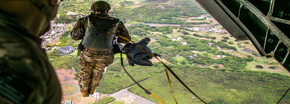 MARINE CORPS TRAINING AREA BELLOWS, Hawaii (Aug. 14, 2019) - A U.S. Armed Service member jumps out of a CH-53E Super Stallion during parachute training operations over Marine Corps Training Area Bellows, Hawaii, August 14, 2019. The training supported by Marine Heavy Helicopter Squadron 463, Marine Aircraft Group 24, was conducted for Armed Service members to maintain their parachute qualification requirements.