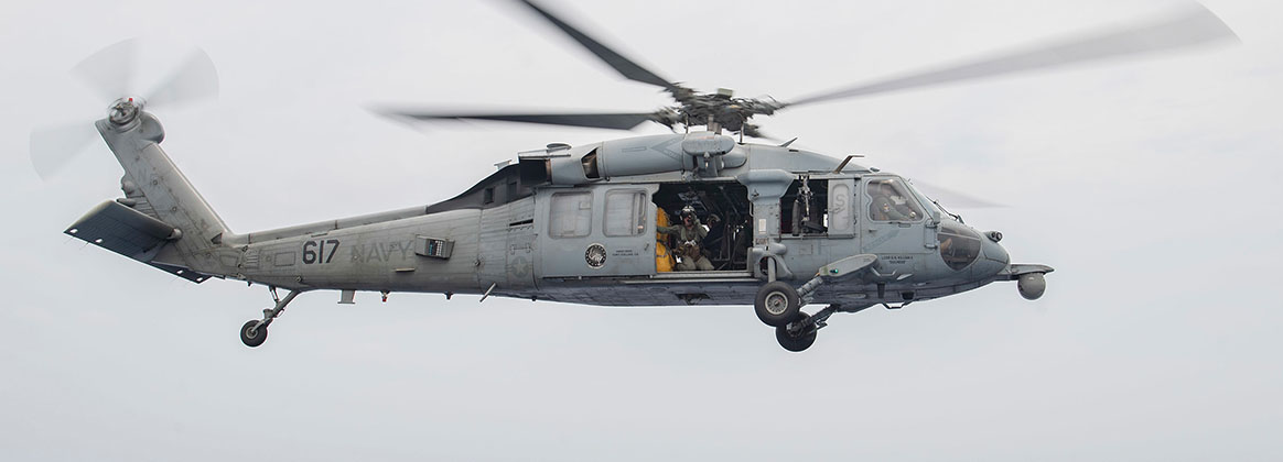 "PHILIPPINE SEA (Aug. 15, 2019) - Rear Adm. Karl O. Thomas, Commander, Task Force 70, departs the Ticonderoga-class guided-missile cruiser USS Chancellorsville (CG 62) on an MH-60S Sea Hawk assigned to the ""Golden Falcons"" of Helicopter Sea Combat Squadron 12 after a ship visit. Chancellorsville is forward-deployed to the U.S. 7th Fleet area of operations in support of security and stability in the Indo-Pacific region."