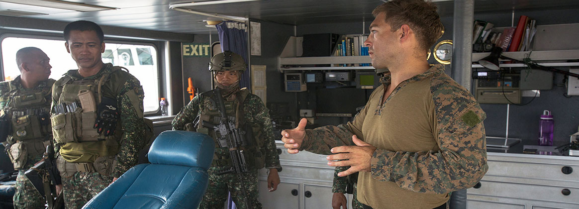 "MANILA, Philippines (Oct. 16, 2019) - U.S. Marine Sgt. Sebastian Sawyer discusses the layout of the ship with Philippine Marines aboard the BRP Pampanga (SARV-003) in Ermita, Manila, Philippines, Oct. 16, 2019. KAMANDAG advances military modernization and capability development through subject matter expert exchanges. Sawyer, a native of Sacramento, Calif., is a radio telephone operator with Bravo Company, 3rd Reconnaissance Battalion. KAMANDAG is an acronym for the Filipino phrase ""Kaagapay Ng Mga Manirigma Ng Dagat,"" which translates to ""Cooperation of the Warriors of the Sea,"" highlighting the partnership between the U.S. and Philippine militaries."