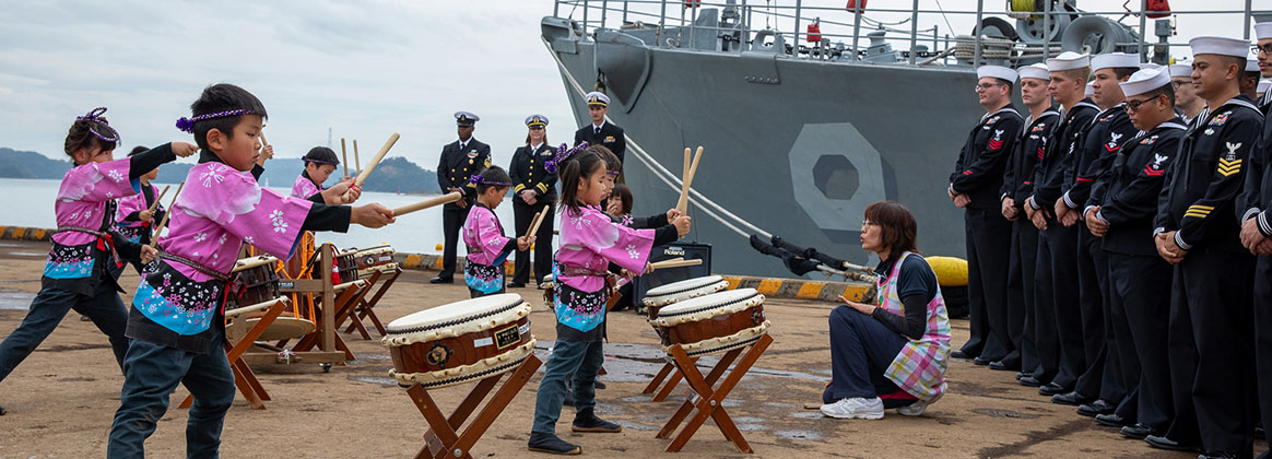 UKI, Japan (October 18, 2019) - Kindergarteners from Uki, Japan give a musical performance on Wadaiko, a type of traditional Japanese drums for the crew of the Avenger-class mine countermeasures ship USS Pioneer (MCM 9) during a port visit to Uki, Oct. 18, 2019. Pioneer, part of Mine Countermeasures Squadron 7, is operating in the U.S. 7th Fleet area of operations to enhance interoperability with partners and serve as a ready-response platform for contingency operations.