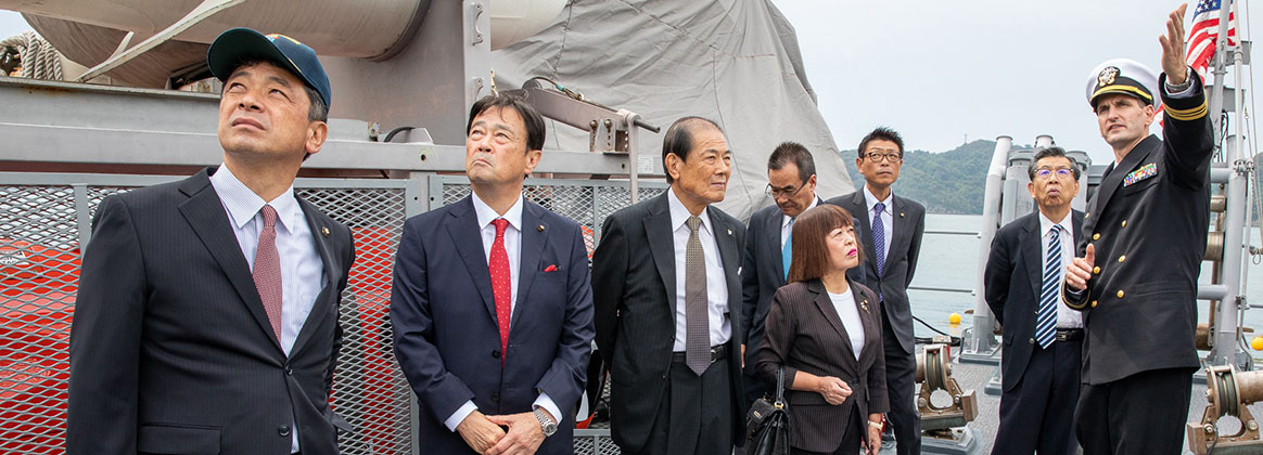 UKI, Japan (October 18, 2019) - Commanding officer of Avenger-class mine countermeasures ship USS Pioneer (MCM 9), Lt. Cmdr. Bobby Wayland, gives a ship tour to the mayor of Uki city, Kenshi Morita and his staff. Pioneer, part of Mine Countermeasures Squadron 7, is operating in the 7th Fleet area of operations to enhance interoperability with partners and serve as a ready-response platform for contingency operations.