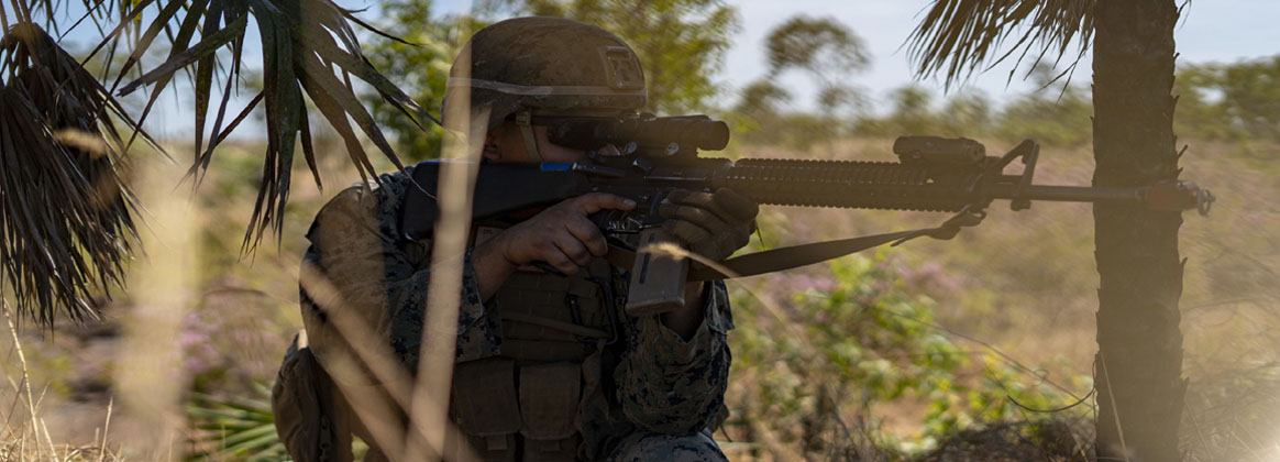 DARWIN, NT, Australia (July 13, 2020) - U.S. Marine Lance Cpl. Richard Chargualaf with Logistics Combat Element, Marine Rotational Force - Darwin provides security during a patrol at Robertson Barracks, NT, Australia, July 13, 2020. During the patrol, Marines practiced fire and maneuver, terrain familiarization, tactical combat casualty care, and radio communication skills. This training helps keep MRF-D postured to respond to regional crises, from humanitarian aid to offensive operations.