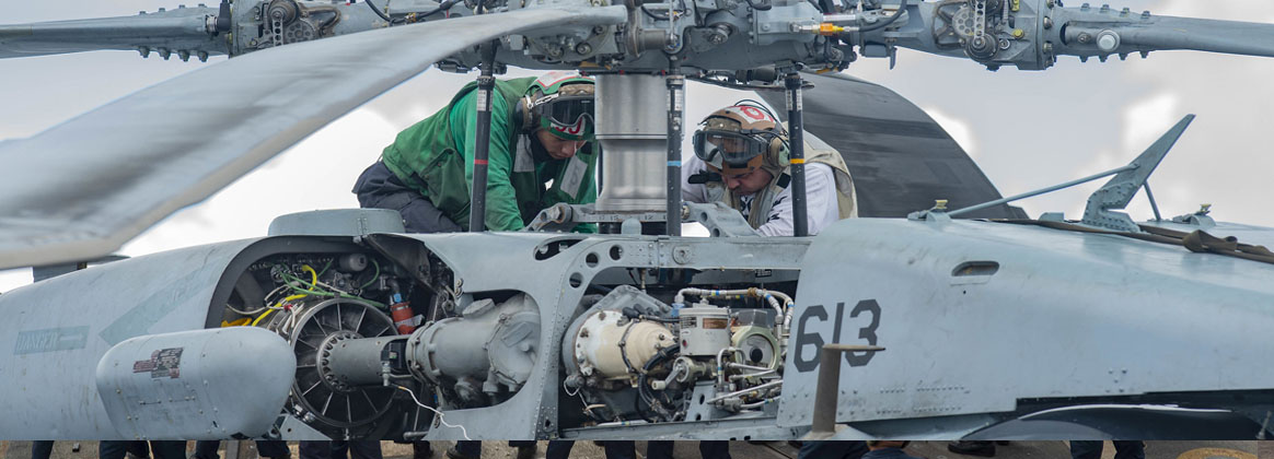 PHILIPPINE SEA (July 13, 2020) - Sailors troubleshoot an MH-60S Sea Hawk helicopter, from the
