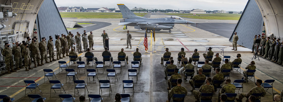 MISAWA AIR BASE, Japan (July 31, 2020) -  U.S. Air Force Airmen from Team Misawa gather during a Dedicated Crew Chief ceremony at Misawa Air Base, Japan, July 31, 2020. During the ceremony, crew chiefs took the crew chief oath and received a certificate, coin and patch commemorating the event. DCCs spend countless hours assigned to a single aircraft, inspecting and maintaining every square inch of their aircraft, and are ultimately responsible for not only that aircraft, but also the safety of their pilots.