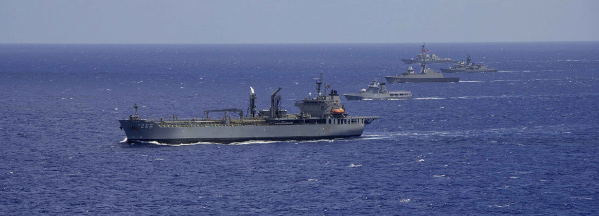 PACIFIC OCEAN (Aug. 2, 2020) - The Royal Australian Navy support ship HMAS Sirius (O 266), front, the Royal Brunei Navy Darussalam-class offshore patrol vessel KDB Darulehsan (OPV-07), the Republic of Singapore Navy Formidable-class RSS Supreme (73), the Anzac-class frigate HMAS Stuart (FFH 153) and the Arleigh Burke-class guided-missile destroyer USS Rafael Peralta (DDG 115) sail in formation as they transit the Pacific Ocean.