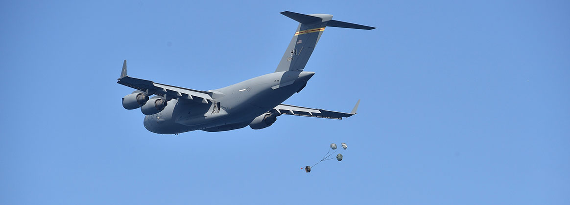 PACIFIC OCEAN (Oct. 22, 2020) -- A C-17 Globemaster III, attached to the Air Force 535th Airlift Squadron, delivers a payload to the Ohio-class ballistic-missile submarine USS Henry M. Jackson (SSBN 730) in the vicinity of the Hawaiian Islands. Underway replenishment sustains the fleet anywhere/anytime. This event was designed to test and evaluate the tactics, techniques, and procedures of U.S. Strategic Command's expeditionary logistics and enhance the overall readiness of our strategic forces.