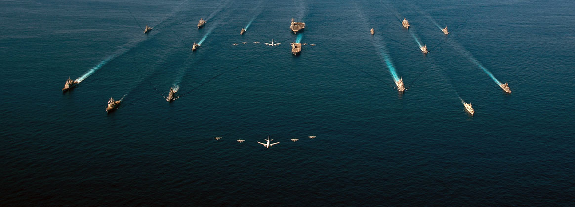 PHILIPPINE SEA (Oct. 26, 2020) - U.S. Navy ships assigned to the Ronald Reagan Carrier Strike Group join ships of Japan Maritime Self-Defense Force (JMSDF) Escort Flotilla 1, Escort Flotilla 4, and the Royal Canadian Navy in formation while aircraft from the U.S. Navy, U.S. Marine Corps, U.S. Air Force, JMSDF and Japan Air Self-Defense Force fly overhead during Keen Sword 21. Keen Sword is an example of the strength of U.S.-Japan Alliance, the foundation of peace and security in the Indo-Pacific region for almost 60 years. The relationships built and maintained during these events are critical to our shared capability to respond to contingencies at a moment's notice.