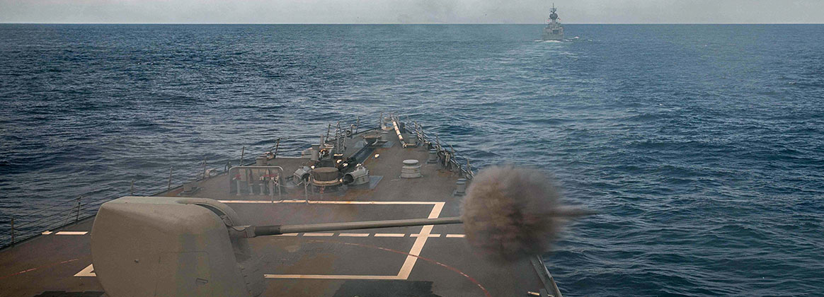 SOUTH CHINA SEA (June 6, 2021) – The Royal Australian Navy Anzac-class frigate HMAS Ballarat (FFH 155) steams ahead of Arleigh Burke-class guided-missile destroyer USS Curtis Wilbur (DDG 54) during a joint live-fire exercise. Curtis Wilbur is assigned to Commander, Task Force 71/Destroyer Squadron (DESRON) 15, the Navy's largest forward-deployed DESRON and U.S. 7th Fleet's principal surface force.