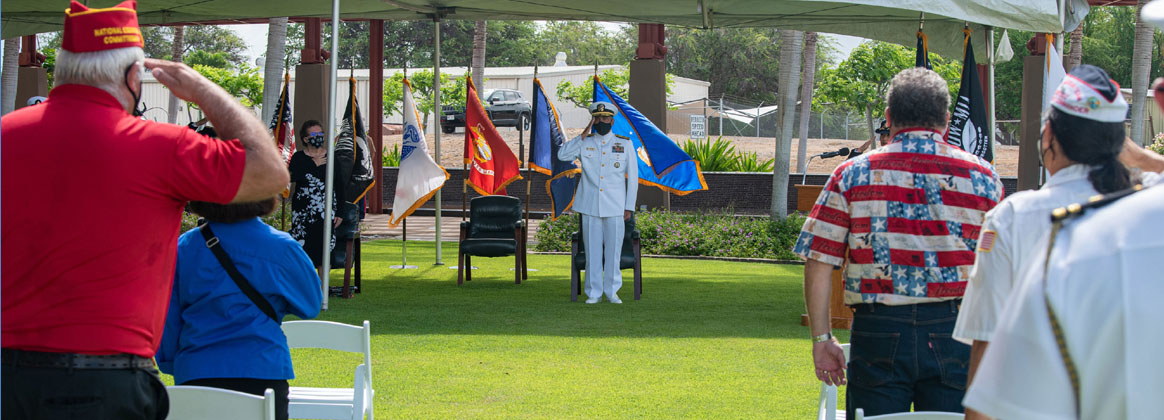 HONOLULU, Hawaii (Sept. 17, 2021) - U.S. Navy Rear Adm. Darius Banaji, deputy director for operations for the Defense POW/MIA Accounting Agency (DPAA), renders a salute during a ceremony for National POW/MIA Recognition Day at the DPAA facility on Joint Base Pearl Harbor-Hickam, Hawaii, Sept. 17, 2021. First established in 1979, through a proclamation from President Jimmy Carter, National POW/MIA Recognition Day, is an observance to honor and recognize the sacrifices of those Americans who have been a POW, and to remind the nation of those who are still MIA. DPAA is conducting worldwide operations to provide the fullest possible accounting of those classified as still missing.