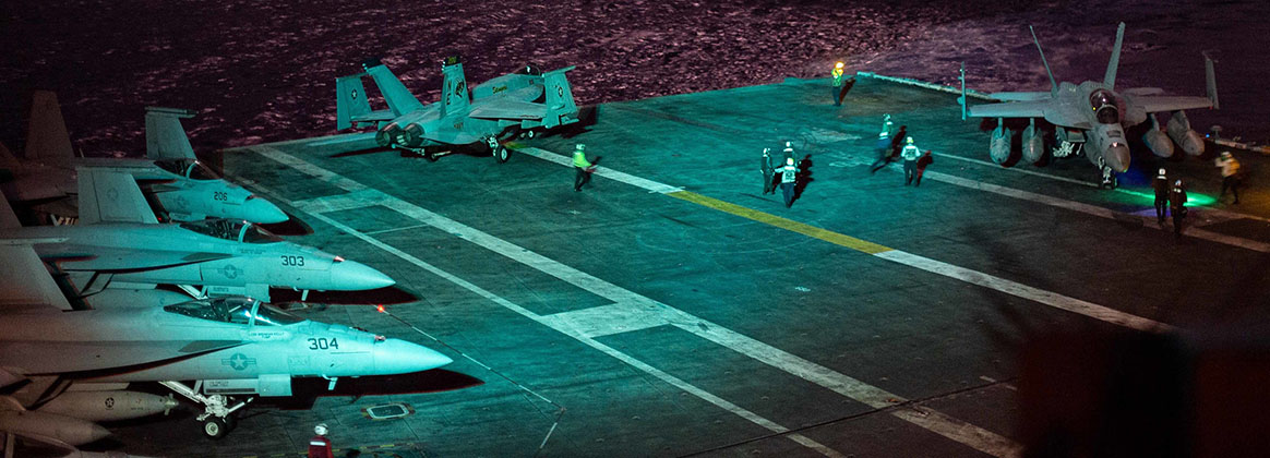 """PHILIPPINE SEA (Sept. 17, 2021) - An F/A-18E Super Hornet, assigned to the """"Stingers"""" of Strike Fighter Squadron (VFA) 113, taxis on the flight deck aboard Nimitz-class aircraft carrier USS Carl Vinson (CVN 70), Sept. 17, 2021. Carl Vinson Carrier Strike Group is on a scheduled deployment in the U.S. 7th Fleet area of operations to enhance interoperability through alliances and partnerships while serving as a ready-response force in support of a free and open Indo-Pacific region."""