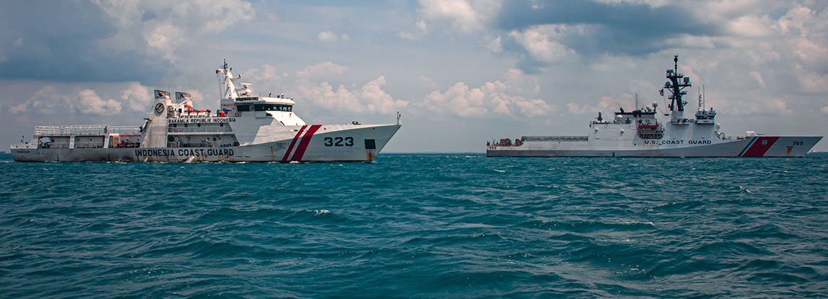 SINGAPORE STRAIT (Sept. 20, 2021) - The U.S. Coast Guard Legend-class cutter USCGC Munro (WMSL 755) steams in formation with Indonesia Coast Guard Vessel KN Pulau Dana during a maritime engagement with the Indonesia Coast Guard in the Singapore Straight, Sept. 20, 2021. Coast Guard Cutter Munro is currently deployed in the western Pacific Ocean to strengthen alliances and partnerships, and improve maritime governance and security in the region.
